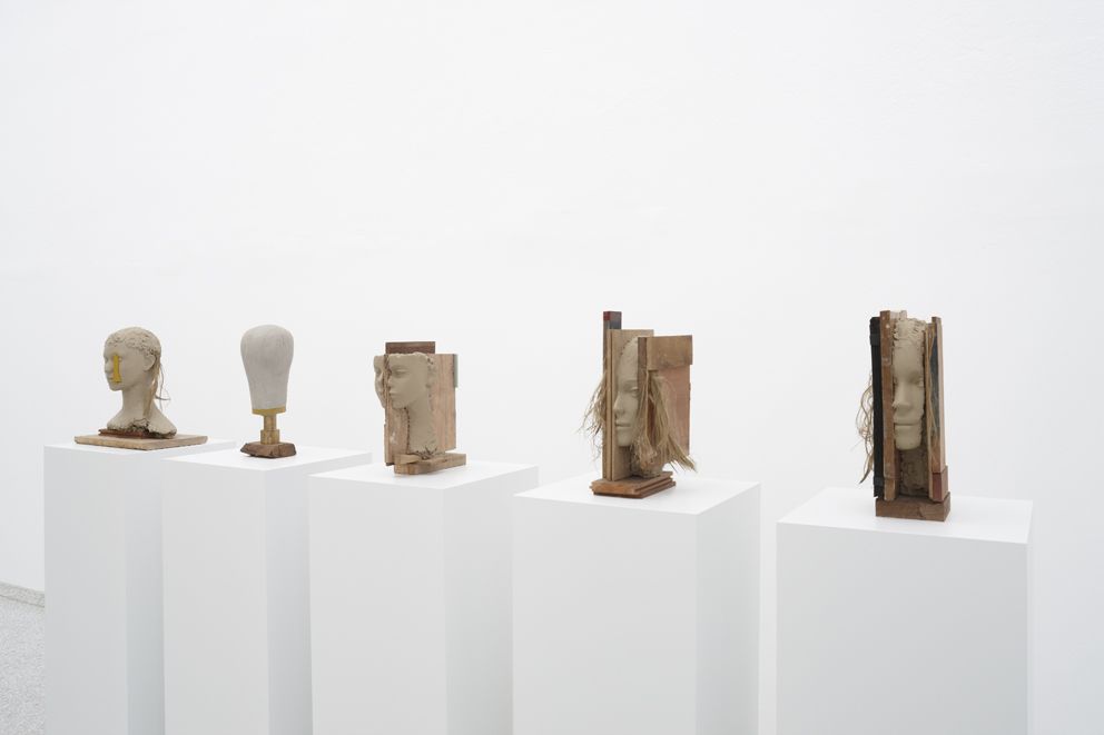 Mark Manders, Girl with Yellow Vertical (2013); Head Study (2012-2013); Head Study (2012-2013); Girl Study (2013); Girl Study (2013) / wood, painted wood, painted epoxy, brass, painted canvas, painted wig / 16.5 x 16 x 41 cm Courtesy of Zeno X Gallery and Tanya Bonakdar Gallery