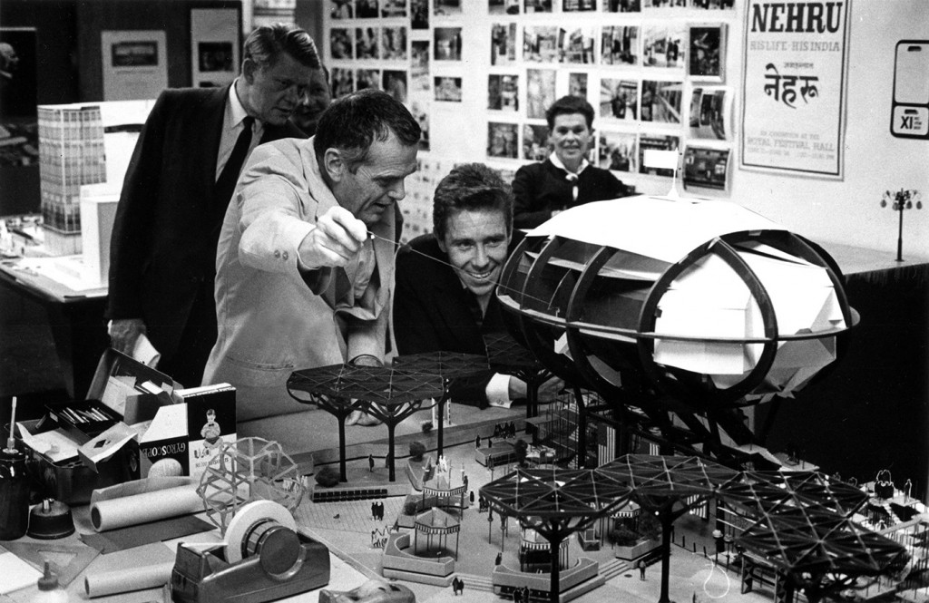 Charles Eames showing Antony Armstrong-Jones model of the I.B.M. Pavilion for the 1964-65 New York World's Fair. © Eames Office LLC.