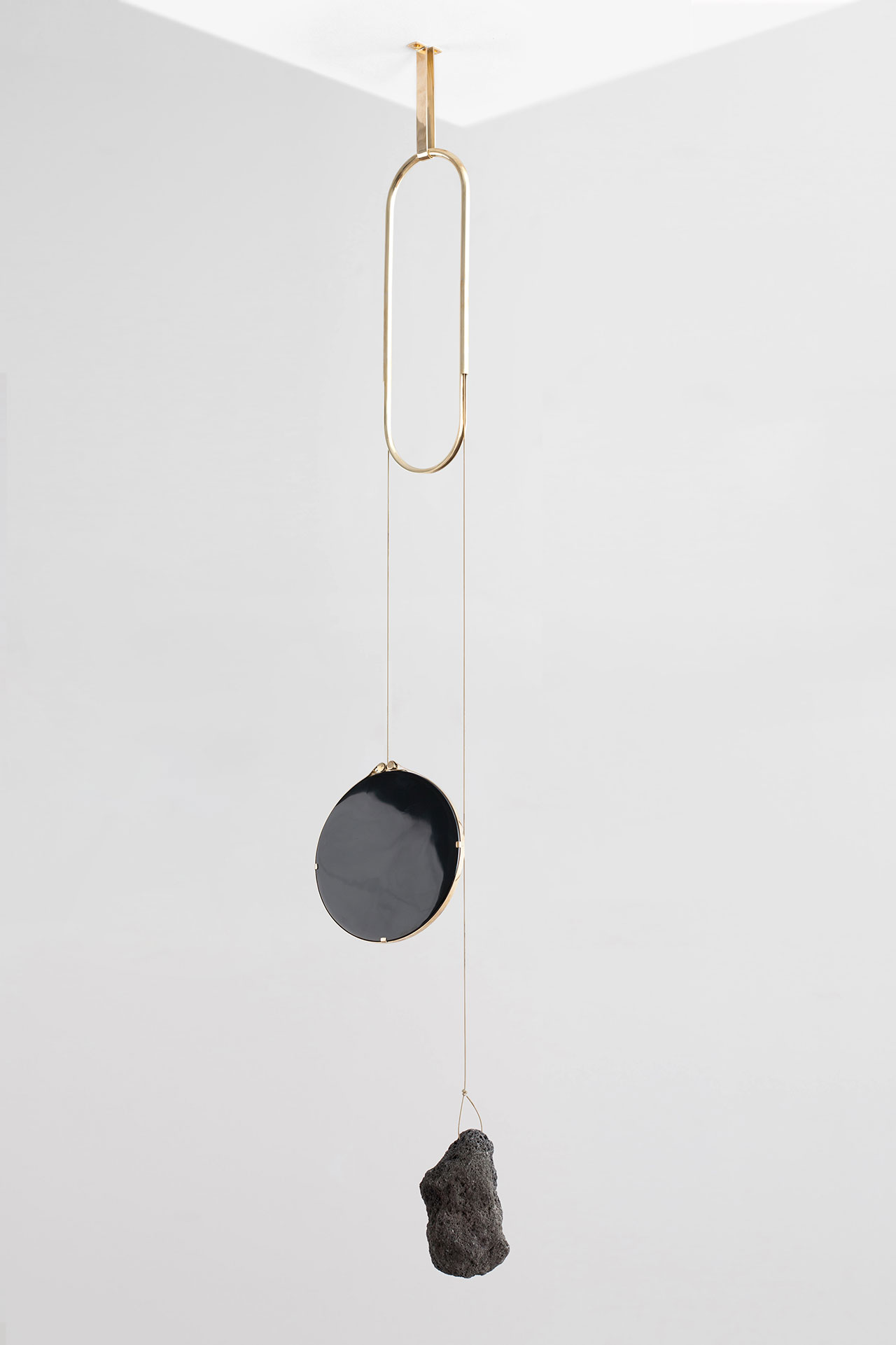 Formafantasma: Andrea Trimarchi and Simone Farresin for Gallery Libby Sellers, Iddu mirror, from De Natura Fossilium collection, 2014, Obsidian mirror, lava rock, brass. © Studio FormaFantasma.