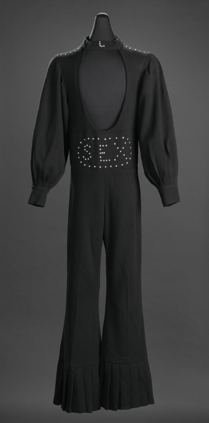 "Black ""Sex"" jumpsuit owned by James Brown 1970-1989. Collection of the Smithsonian National Museum of African American History and Culture."