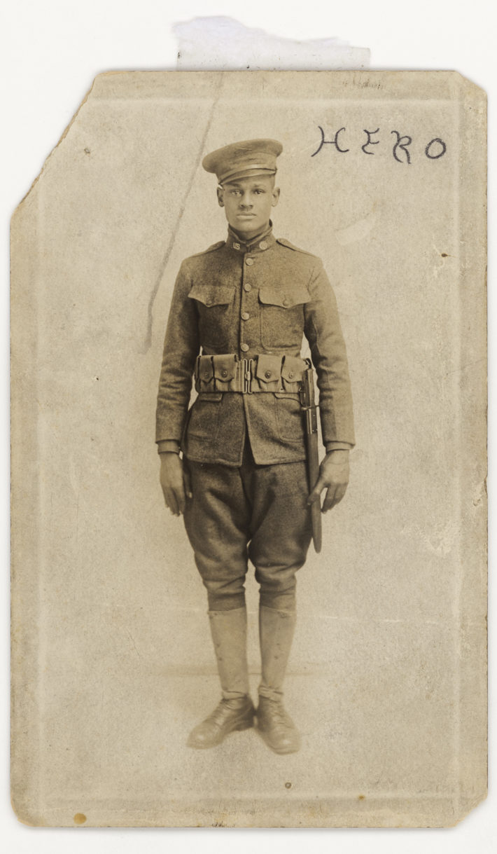 Photograph by A. P. Mitchell. Subject of Lawrence Leslie McVey. Subject of 369th Infantry, United States Army. Photographic postcard of Lawrence McVey in uniform 1914 - 1918. Collection of the Smithsonian National Museum of African American History and Culture, Gift of Gina R. McVey, grand daughter.
