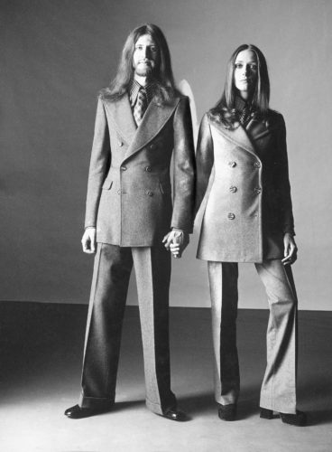 """Man's suit by Walter Albini for Basile, Courlande woman's suit, from the feature """"Unilook. Lui e lei alla stessa maniera,"""" L'uomo Vogue, no. 15, December 1971-January 1972. Photo: Oliviero Toscani."""