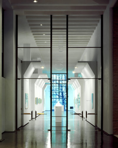 Fitting out of the entrance area of the Palazzo dell'Arte, Triennale, Milan, 1994-95. The large glass door leading to the gallery. Photo: Francesco Radino.