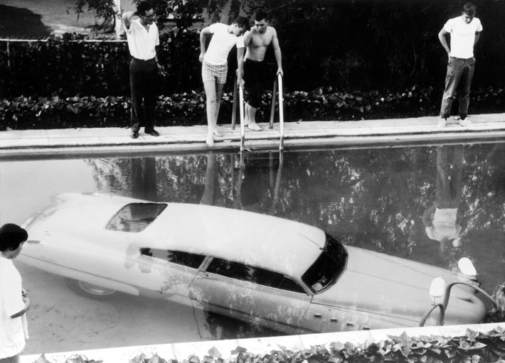 Car parked in swimming pool, Beverly Hills, California, May 4, 1961. © Keystone and Getty Images.