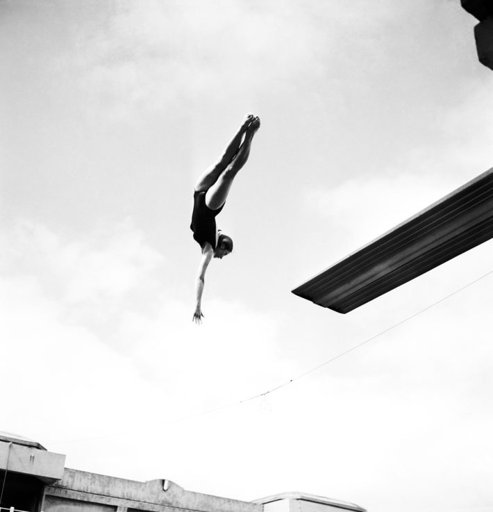 Blandine Fagedet, winner of the female diving contest at the Piscine Georges-Vallerey in Paris, July 13, 1962. © Keystone France and Gamma-Rapho via Getty Images.