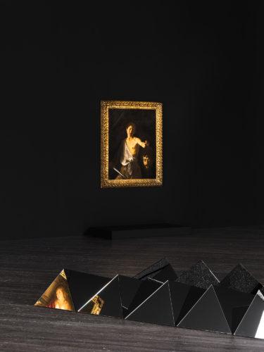 In the foreground: Carla Arocha and Stéphane Schraenen, Circa Tabac, 2007. In the background: Caravaggio, David with the Head of Goliath, 1609-10. Image of the exhibitionSanguine. Luc Tuymans on Baroque, Fondazione Prada. Photo: Delfino Sisto Legnani and Marco Cappelletti. Courtesy Fondazione Prada.