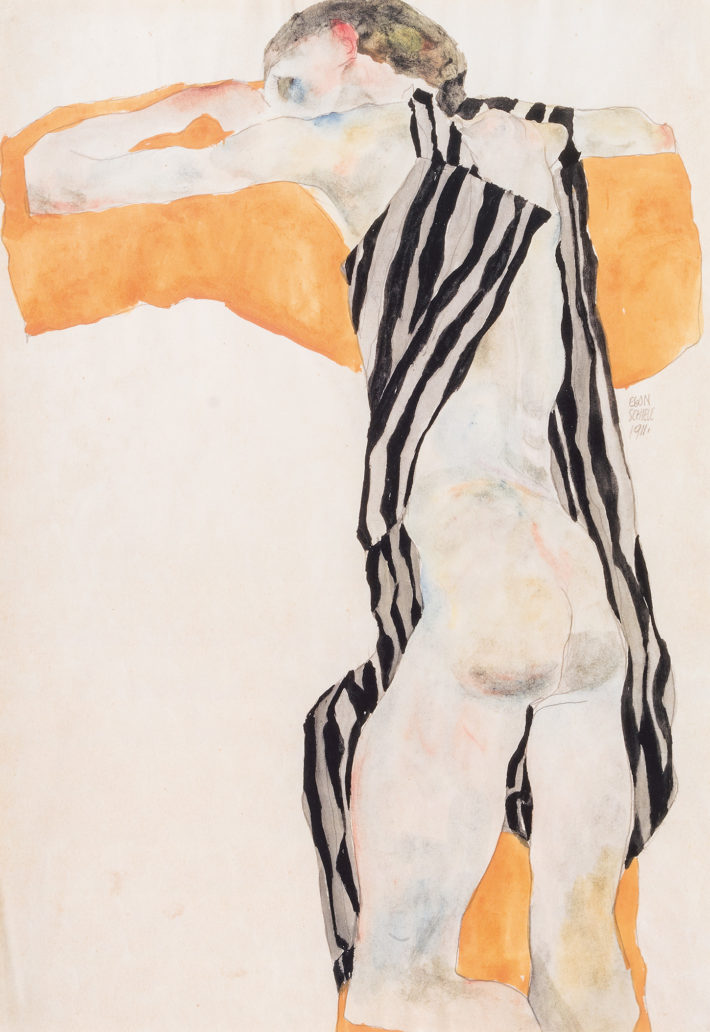 Egon Schiele, Liegender Mädchenakt in gestreiftem Kittel (Reclining Nude Girl in Striped Smock), 1911. Pencil and watercolor on paper. Private collection, Vienna. Courtesy of Kunsthandel Giese & Schweiger, Vienna Picture: © Kunsthandel Giese & Schweiger, Vienne.