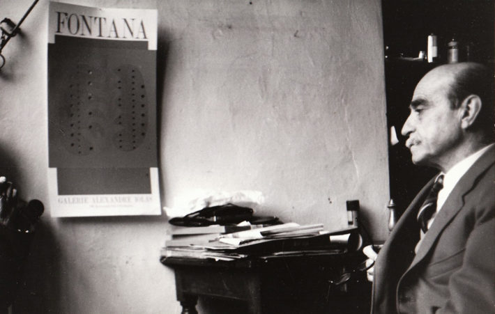 Lucio Fontana in his studio, 1966. Photo: Giuseppe Loy,© Archivio Giuseppe Loy.